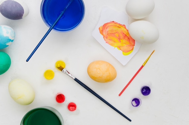 Top view of painted eggs for easter with assortment of dyes