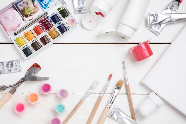 Top view of painting essentials with brushes