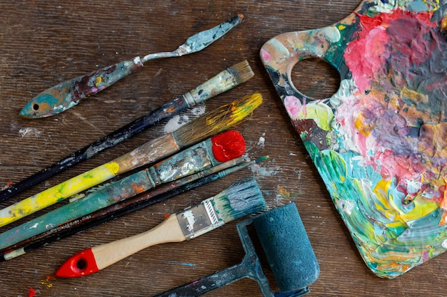 Top view painting tools on table