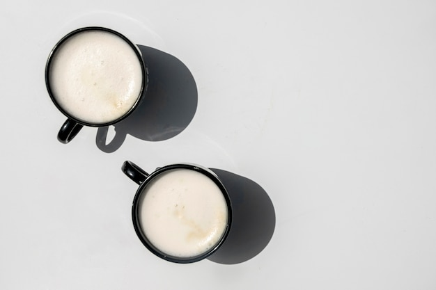 Top view pair of cups of coffee
