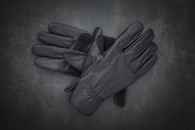 Top view of pair of new black leather motorcycle gloves
