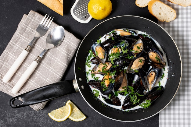Top view pan with tasty mussel sauce
