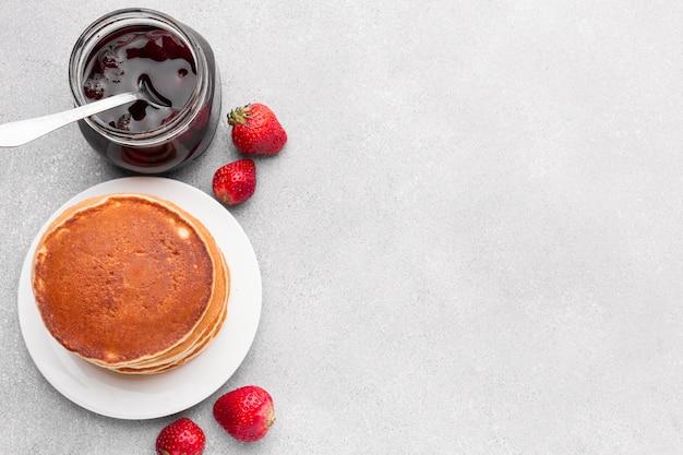 Top view pancakes arrangement with jam