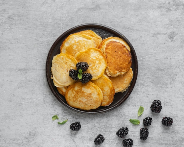 Top view pancakes with blackberries