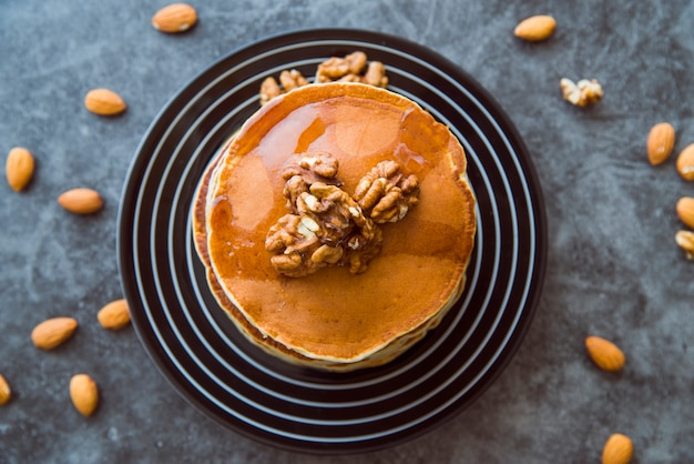 Top view pancakes with walnuts