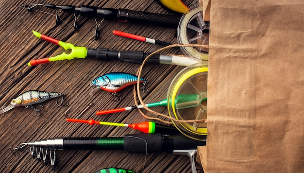 Top view of paper bag with fishing essentials