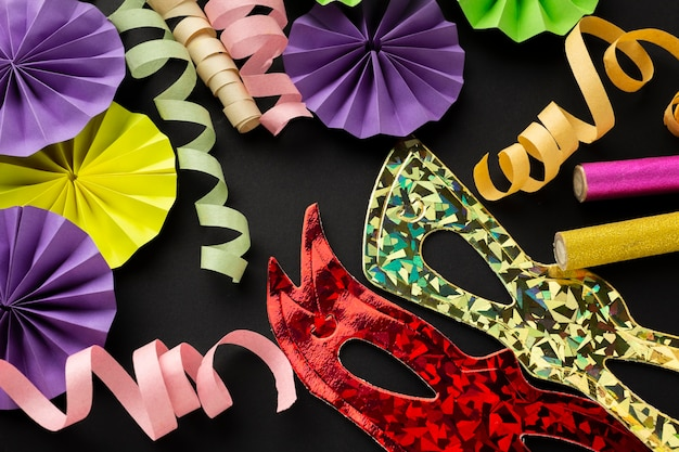 Top view paper carnival decorations and masks