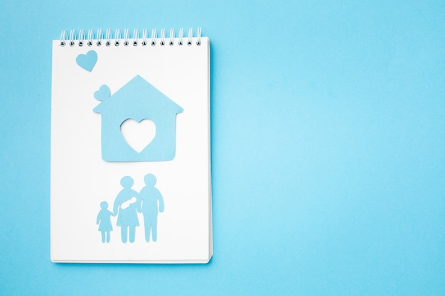 Top view paper cut family and home with copy space