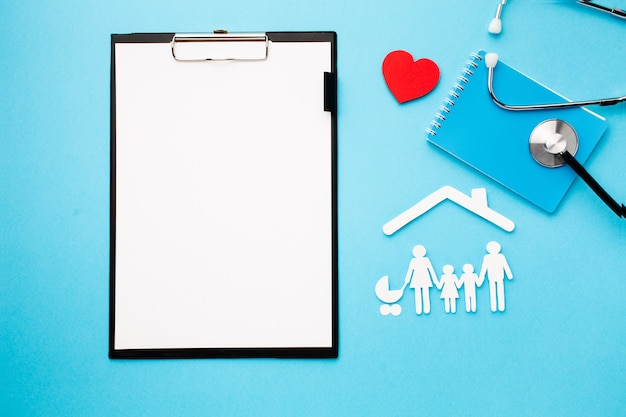Top view paper cut family with clipboard