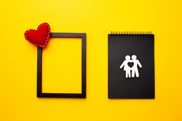 Top view paper cut family with frame and heart