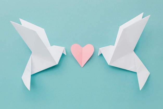 Top view of paper doves with heart