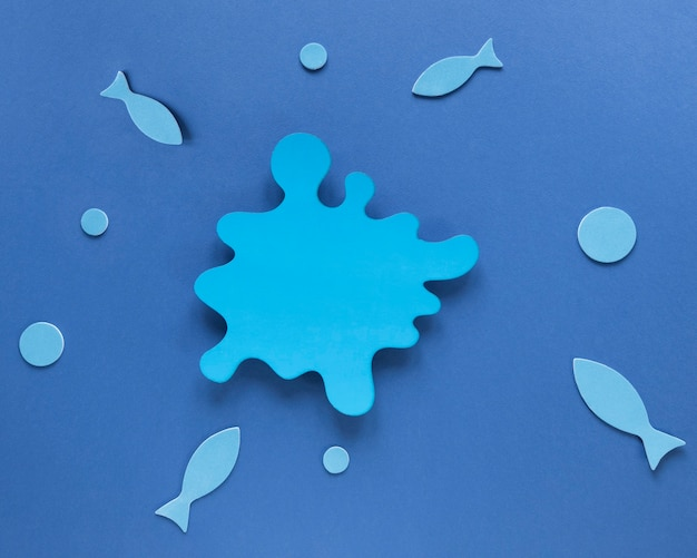 Top view of paper fish with stain and circles