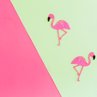 Top view of paper flamingos