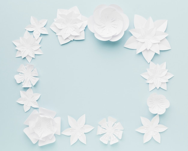 Top view paper flowers frame on table