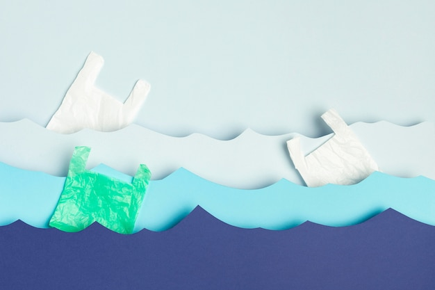 Top view of paper ocean waves with plastic bags