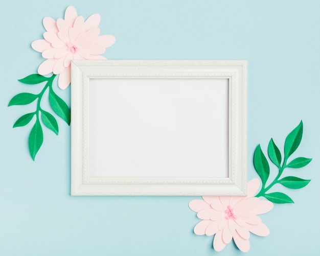 Top view of paper spring flowers with frame