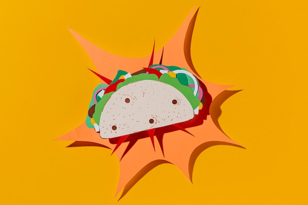 Top view paper taco on yellow background