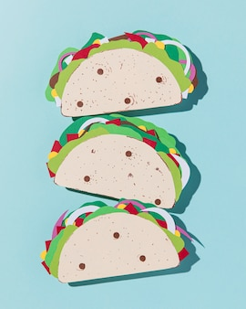 Top view paper tacos on blue background