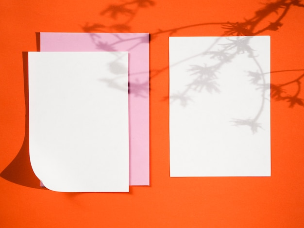 Top view papers on a red background