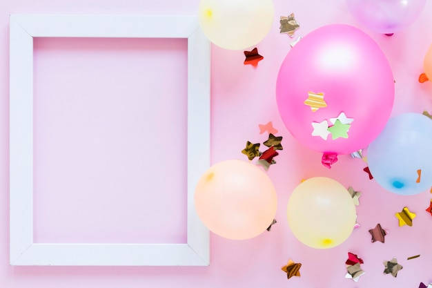 Top view party balloons and frame