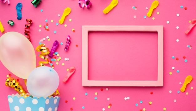 Top view party decoration with pink frame