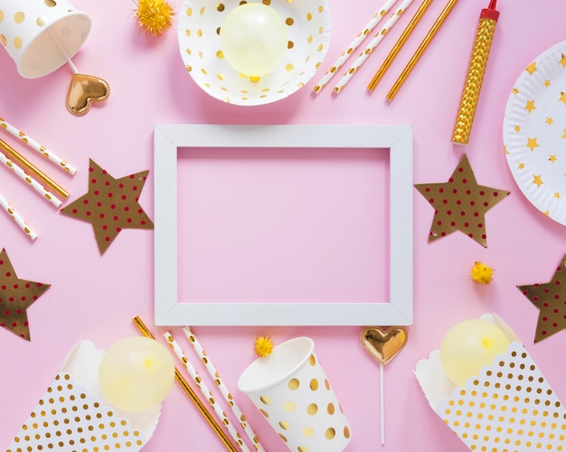 Top view party items with white frame