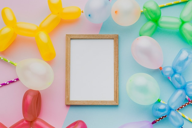 Top view party wooden frame with balloons