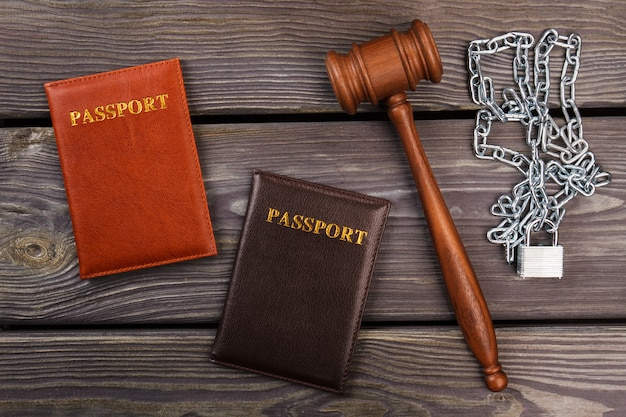 Top view passports gavel and chains. immigration problem concept.