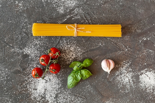 Top view of pasta and cherry tomatoes