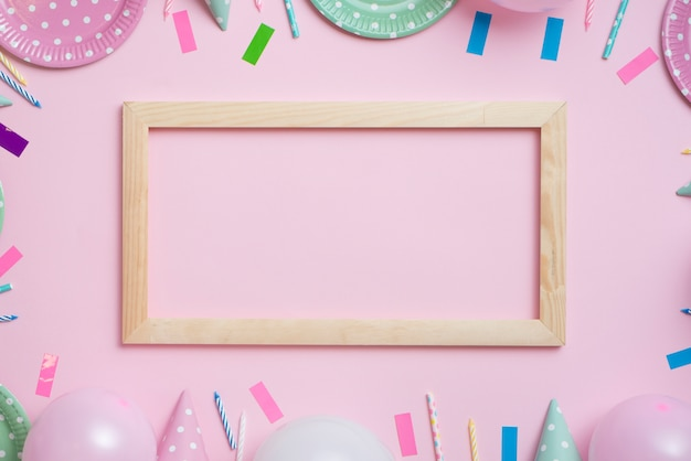Top view pastel color party tablewear with wooden frame