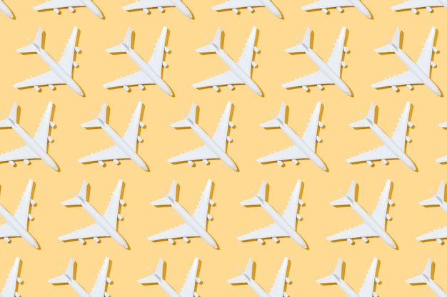 Top view of pattern of white airplanes on a yellow background travel and summer 3d illustration