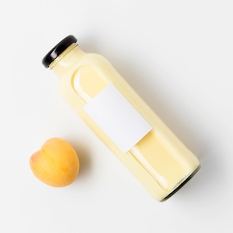 Top view of peach juice bottle