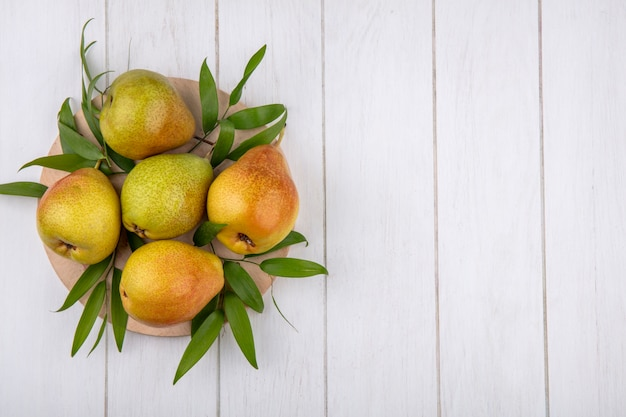 Top view of peaches on cutting board and wooden surface