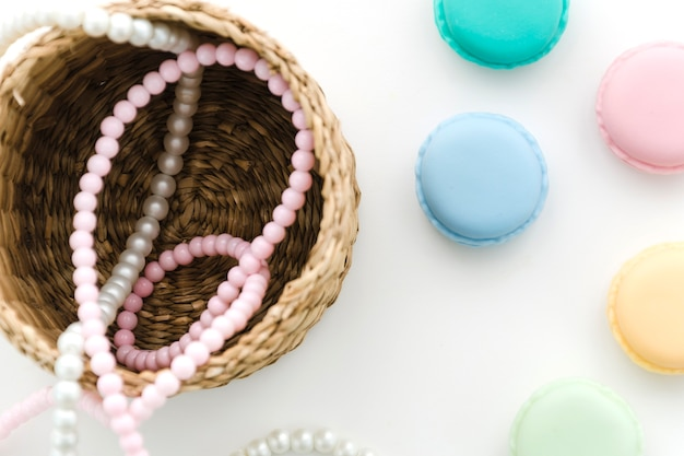 Top view pearl necklace with macarons