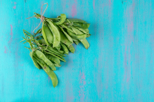 Top view of peas on blue surface