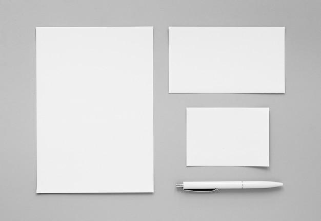 Top view pen and paper sheets arrangement