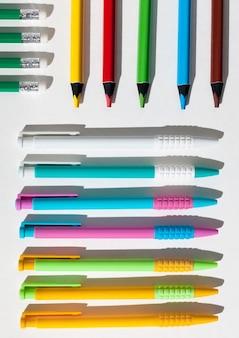 Top view pencils and pens arrangement