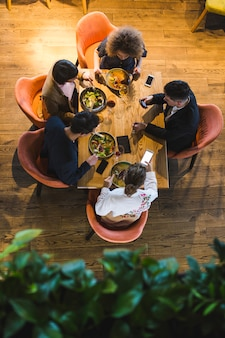 Top view of people at table in restaurant