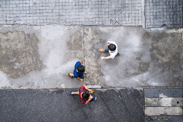 Top view of people traveling walking in the city