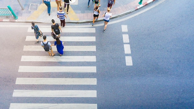 Top view of  people walk on the crosswalk with white sign pedestrian
