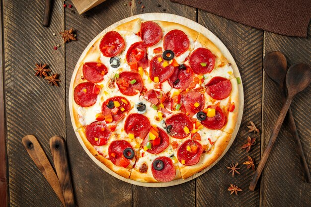 Top view on pepperoni pizza with bell pepper and salami
