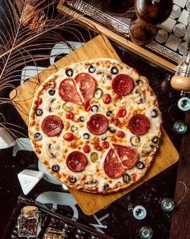 Top view of pepperoni pizza with olive mushroom and cheese
