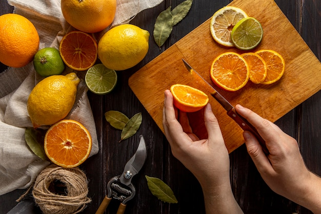 Top view of person chopping citrus fruits