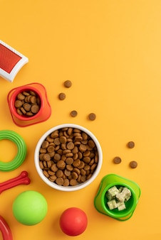 Top view on pet accessories still life with food bowls