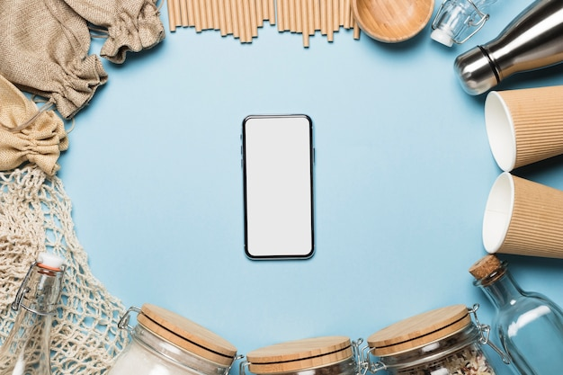 Top view phone mock-up with eco friendly objects