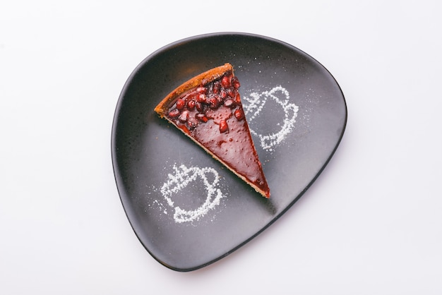 Top view photo of berries tart over white surface