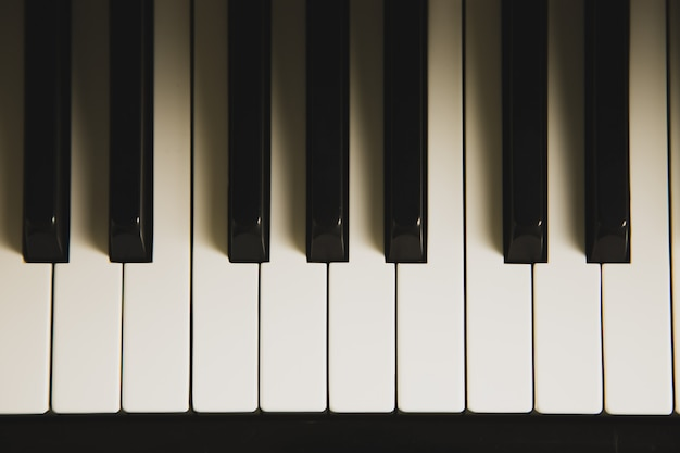 Top view of the piano keyboard with lighting and shadow.