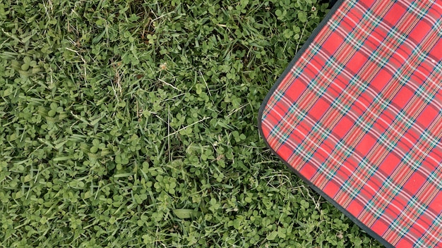 Top view picnic blanket on park grass