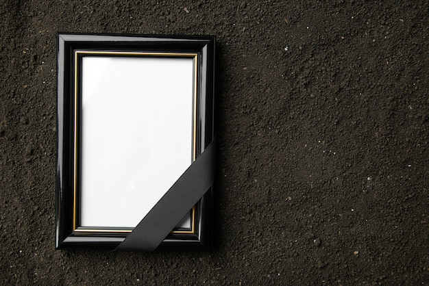 Top view of picture frame on a dark soil
