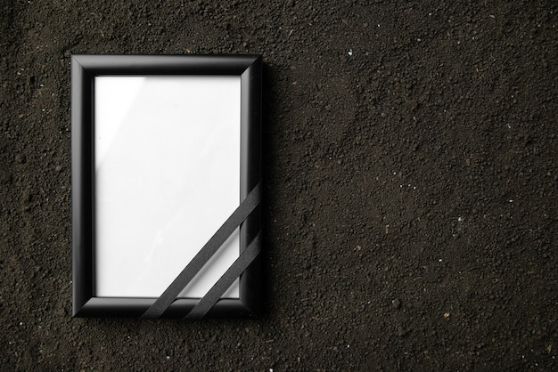 Top view of picture frame on dark soil